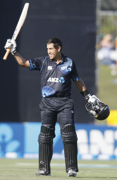 Ross Taylor of New Zealand celebrates scoring 100 runs against England during the second cricket match, in Napier