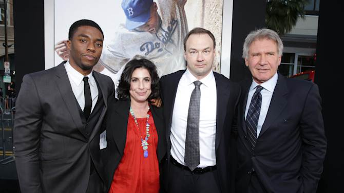 """Chawick Boseman, Warner Bros.' Sue Kroll, Producer Thomas Tull and Harrison Ford at The Los Angeles Premiere of Warner Bros. Pictures' and Legendary Pictures' """"42"""", on Tuesday, April, 9th, 2013 in Los Angeles. (Photo by Eric Charbonneau/Invision for Warner Bros./AP Images)"""