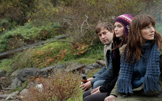 "This film image released by IFC Films shows, from left, Mark Duplass, Emily Blunt and Rosemarie DeWitt in a scene from ""Your Sister's Sister."" (AP Photo/IFC Films, Steven Schardt)"