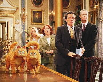 Garfield (voiced by Bill Murray ) with his look-alike Prince (voiced by Tim Curry ), along with Abby ( Lucy Davis ), Mrs. Whitney ( Jane Carr ), Mr. Greene ( Oliver Muirhead ) and Mr. Hobbs ( Roger Rees ) in 20th Century Fox's Garfield: A Tail of Two Kitties