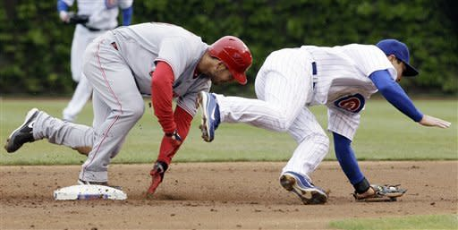 Reds get 10,000th victory, 9-4 over Cubs