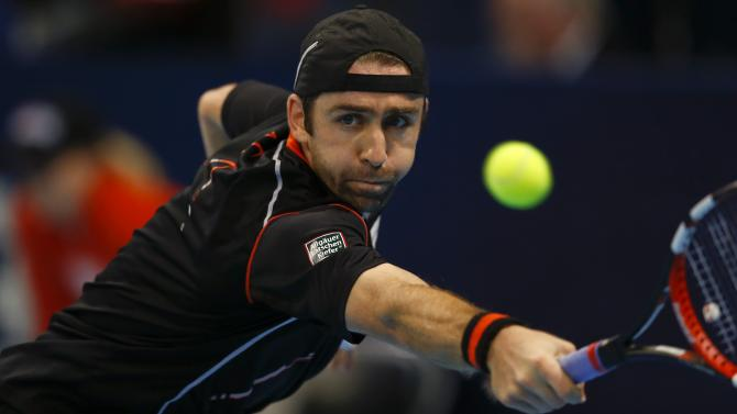 Becker of Germany prepares to return the ball to Croatia's Karlovic at the Swiss Indoors ATP tennis tournament in Basel