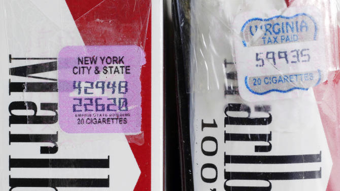 In this Tuesday, April 30, 2013 photo, two packs of Marlboro cigarettes, the one on the left with a New York City and state tax stamp, and on the right a Virginia tax stamp, are displayed for a photo, in New York. New York City's war on smoking is being undercut by light penalties for merchants caught selling cheap cigarettes smuggled in from low-tax states. (AP Photo/Mark Lennihan)