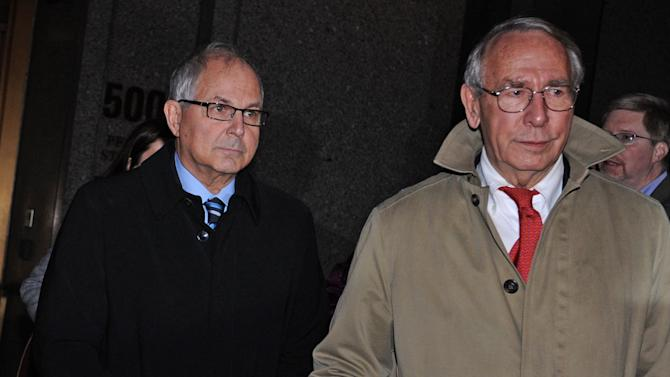 Peter Madoff, left, and his attorney John Wing exit Manhattan federal court after receiving a his sentence, Thursday, Dec. 20, 2012, in New York. The brother of imprisoned financier Bernard Madoff was sentenced Thursday to 10 years in prison for crimes committed in the shadow of his notorious sibling by a judge who said she disbelieved his claims that he did not know about the epic fraud. (AP Photo/Louis Lanzano)