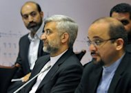 Chief Iranian nuclear negotiator Saeed Jalili (2nd L) takes part in the talks on the controversial Iranian nuclear programme in Moscow, in June. The US Congress Wednesday approved punishing new sanctions targeting Iran's energy and shipbuilding sectors, a day after President Barack Obama unveiled measures to cripple Tehran's nuclear drive.