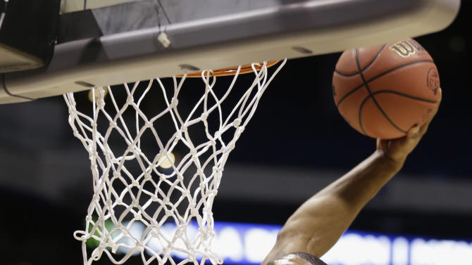 Oregon forward Carlos Emory goes up for a dunk during practice for a regional semifinal game in the NCAA college basketball tournament Thursday, March 28, 2013, in Indianapolis. Oregon plays Louisville on Friday. (AP Photo/Michael Conroy)