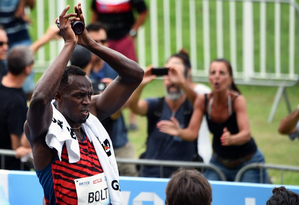 Bolt ignores doping's ugly head as US triumphs