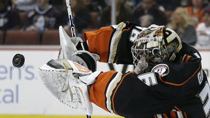 Anaheim Ducks goalie John Gibson deflects the puck during the first period of an NHL hockey game against the San Jose Sharks on Wednesday, April 9, 2014, in Anaheim, Calif