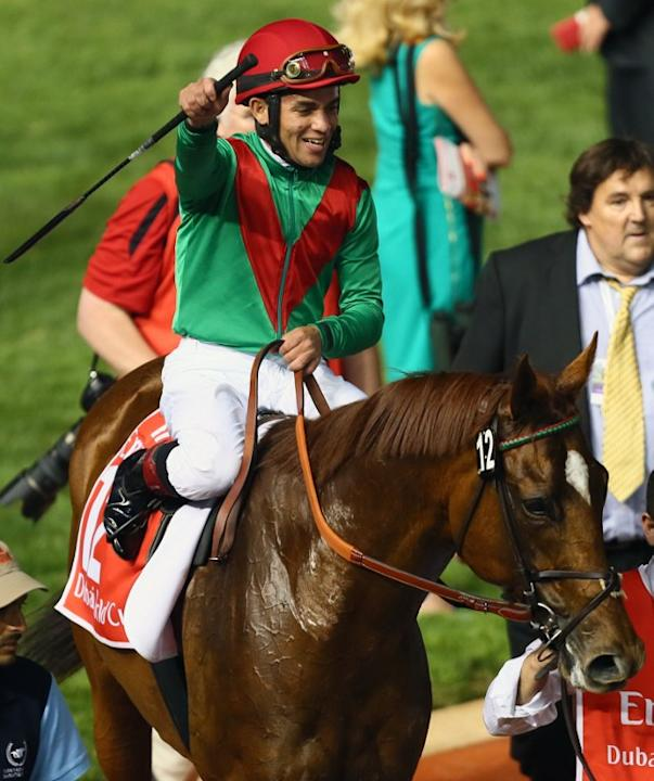 Jockey Joel Rosario jubilates after leading Animal Kingdom to win the 10 million dollar Dubai World Cup, the world's richest race, at Meydan race track in Dubai  March 30, 2013. The 2011 Kentucky Derb