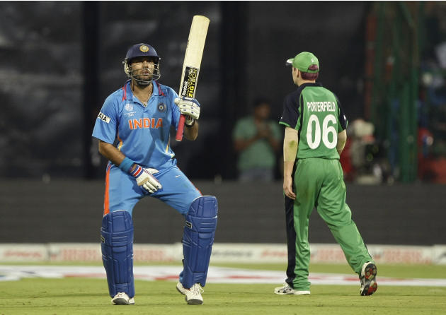 India's Yuvraj Singh reacts after scoring fifty as Irish captain William Porterfield walks away during the ICC Cricket World Cup match against Ireland in Bangalore, India, Sunday, March. 6, 2011.(AP P