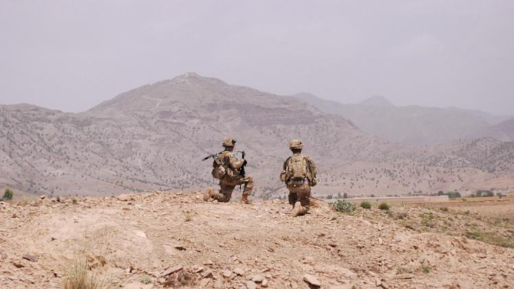 Two soldiers from the 4th Brigade Combat Team, 101st Airborne Division pause during a patrol on Saturday, May 25, 2013 in Khost Province, Afghanistan. In a massive restructuring, the Army announced they will slash the number of active duty combat brigades from 45 to 33 as the service moves forward with a plan to cut the size of the service by 80,000. The 4th Brigade Combat Team, 101st Airborne Division, based at Fort Campbell, Ky., and currently deployed to Afghanistan, is one of those brigades slated to be inactivated by 2017. (AP Photo/Kristin M. Hall)