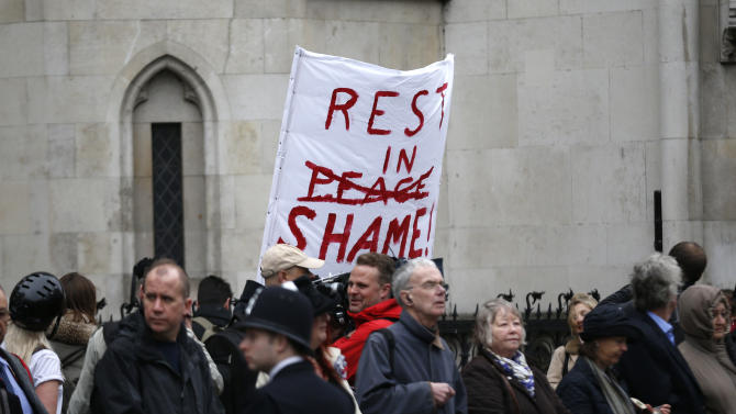 A protest banner is held up along the route of former British Prime Minister Margaret Thatcher's ceremonial funeral procession in London, Wednesday, April 17, 2013. The Iron Lady is being laid to rest — yet even in death, she remains a polarizing figure. World leaders and dignitaries from 170 countries are due to attend the funeral of former British Prime Minister Margaret Thatcher on Wednesday, an elaborate affair with full military honors that will culminate in a service at St. Paul's Cathedral in London. (AP Photo/Matt Dunham, Pool)