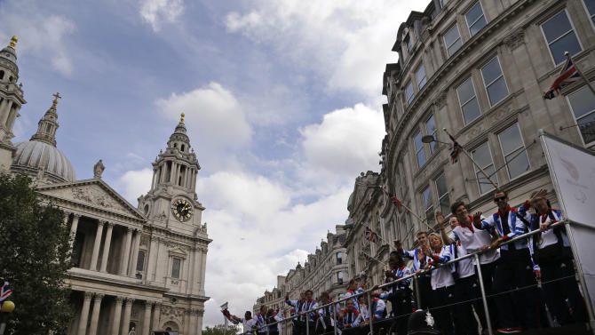 Members of the Team GB Olympic and Paralympic teams parade in the streets of London, Monday, Sept. 10, 2012. Our Greatest Team Parade, the procession of athletes, celebrates the achievements of British Olympians and Paralympians at the London 2012 Games. (AP Photo/Lefteris Pitarakis)