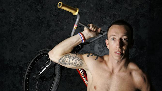 FILE - In this April 16, 2008, file photo, Olympic BMX cyclist Kyle Bennett poses for a portrait during the USOC Media Summit in Chicago. Bennett was killed in an automobile accident early Sunday, Oct. 14, 2012, in eastern Texas. He was 33. (AP Photo/Charles Rex Arbogast, File)