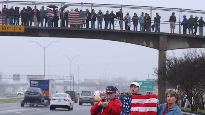 Supporters of Chris Kyle line up along the southbound lane of Interstate 35, Tuesday, Feb. 12, 2013, in Waco, Texas, for his final journey to Austin, where he will be buried at the Texas State Cemetery. Kyle and his friend Chad Littlefield were shot and killed Feb 2. at a North Texas gun range. (AP Photo/Waco Tribune Herald, Rod Aydelotte)