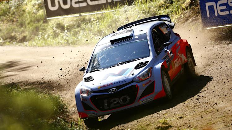 Finnish Juho Hänninen with Hyundai i20 takes a corner during the second day of the World Rally Championship in Jyväskylä, Central Finland, Friday, Aug. 1, 2014. (AP Photo/Lehtikuva, Roni Rekomaa) FINLAND OUT
