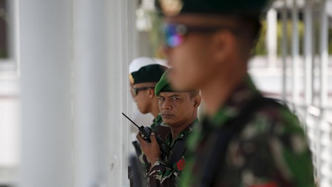 Indonesian soldiers stand guard on a pedestrian overpass ahead of the Asian-African conference in Jakarta