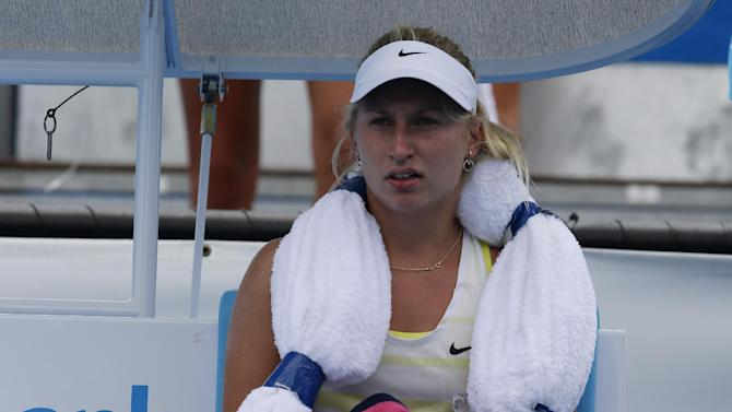 Russia's Daria Gavrilova uses ice bags to cool down during her second round loss to Ukraine's Lesia Tsurenko at the Australian Open tennis championship in Melbourne, Australia, Thursday, Jan. 17, 2013. (AP Photo/Andy Wong)