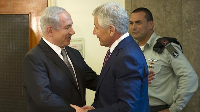 "Israeli Prime Minister Benjamin Netanyahu, left, welcomes U.S. Secretary of Defense Chuck Hagel at his office in Jerusalem, on Tuesday, April 23, 2013. Hagel said the U.S. and Israel need to ensure that their alliance is ""closer than ever,"" as Mideast security challenges grow more complicated.  (AP Photo/Jim Watson, Pool)"