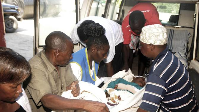 A nurse  and well wishers offload   Benedeta Mueni, from the ambulance at the Coast General Hospital, Mombasa, Kenya, Thursday, March 7, 2013.  She was transfered  from Kinango District Hospital, 120km south west of Mombasa town, for specialized treatment after she was attacked by suspected members of the Mombasa Republican Council (MRC) at their Miamba village in Mkongani location within Kinango District,   The woman was attacked jointly with her husband after more than twenty suspected members of the MRC surrounded their home and slashed them several times with pangas. The other villagers were treated at the Kinango District Hospital with minor panga cuts and discharged. (AP Photo)