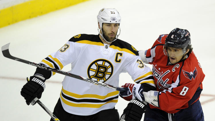 Washington Capitals left wing Alex Ovechkin (8), of Russia, tangles with Boston Bruins defenseman Zdeno Chara (33), of Slovakia, during the first period of Game 6 of an NHL hockey Stanley Cup first-round playoff series, Sunday, April 22, 2012, in Washington. (AP Photo/Nick Wass)