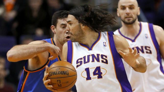 Phoenix Suns forward Luis Scola (14), of Argentina, drives against Oklahoma City Thunder forward Nick Collison during the first half of an NBA basketball game, Monday, Jan. 14, 2013, in Phoenix. (AP Photo/Matt York)