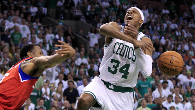 Boston Celtics forward Paul Pierce (34) has the ball swatted away as he drives against Philadelphia 76ers forward Andre Iguodala during the first quarter of Game 7 in an NBA basketball Eastern Conference semifinal playoff series, Saturday, May 26, 2012, in Boston. (AP Photo/Elise Amendola)