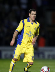 Former Leeds midfielder Andy Hughes, pictured, says Neil Warnock is the right man to take the Yorkshire club back to the Premier League