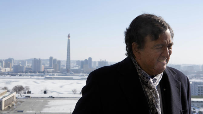 Former New Mexico Bill Richardson stands on a balcony at the Grand Peoples Study House overlooking Juche Tower in Pyongyang, North Korea on Wednesday, Jan. 9, 2013. Richardson said Wednesday that his delegation is pressing North Korea to put a moratorium on missile launches and nuclear tests and to allow more cell phones and an open Internet for its citizens. (AP Photo/David Guttenfelder)