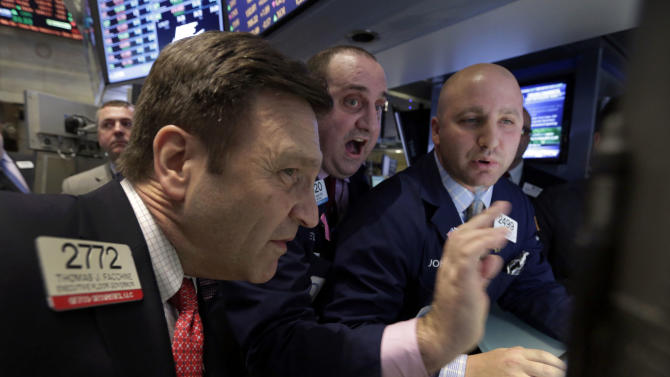 Specialists Thomas Facchine, Peter Giacchi, and John Parisi, left to right, look at thier screens on the floor of the New York Stock Exchange Thursday, Feb. 28, 2013.  The stock market pushed higher Thursday afternoon, sending the Dow tantalizingly close to a record high. (AP Photo/Richard Drew)
