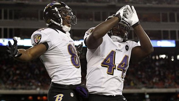 Baltimore Ravens wide receiver Anquan Boldin (81) celebrates his fourth quarter touchdown catch against the New England Patriots with fullback Vonta Leach (44) during the NFL AFC Championship game (Reuters)