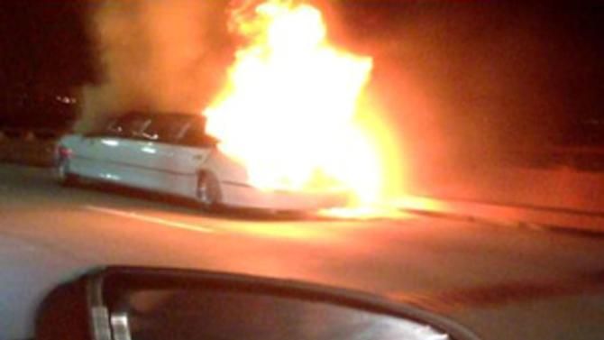 This frame grab taken from video provided by Roxana and Carlos Guzman shows a Limo on fire Saturday, May 4, 2013, on the San Mateo-Hayward Bridge in San Francisco. Five dead female bodies were found pressed up against the partition behind the driver, where they apparently tried to escape the smoke and fire that kept them from the rear exits of the extended passenger compartment. (AP Photo/Roxana and Carlos Guzman)