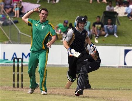 New Zealand's de Boorder runs as Abbott lines up a shy at the stumps during a warm up T20 cricket match against South Africa A in Pietermaritzburg