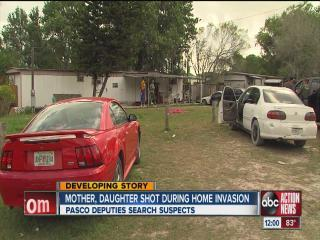 Mom, daughter shot after walking in on invasion