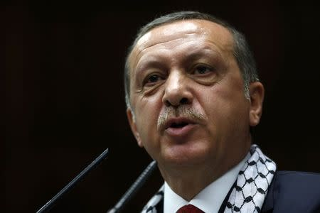 Turkey's PM Erdogan addresses members of parliament from ruling AK Party during meeting at Turkish parliament in Ankara