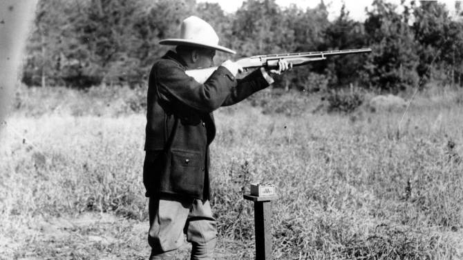 "FILE - In this Sept. 6, 1928 file photo, U.S. President Calvin Coolidge shoots at clay pigeons at his vacation home on the Brule at Superior, Wis, He scored 29 out of 37. The White House has released a photo of President Barack Obama firing a gun, two days before he is set to travel to Minnesota to discuss gun control. It shows Obama shooting at clay targets on the range at Camp David, the presidential retreat in Maryland, where he says he engages in the sport ""all the time."" The image was released at a time when Obama is pushing a package of gun-control measures in response to the Newtown, Conn., school shooting. But the image of a U.S. president holding a gun is certainly nothing new. (AP Photo/File)"