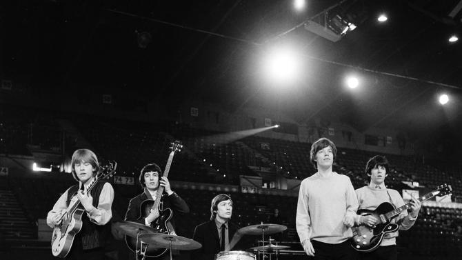 """EMBARGO UNTIL 5 AM FEB. 27, 2013 - FILE - This April 8, 1964 file photo shows The Rolling Stones during a rehearsal at an unknown location. The British band members, from left, are, Brian Jones, guitar; Bill Wyman, bass; Charlie Watts, drums; Mick Jagger, vocals; and Keith Richards, guitar. The Cleveland-based The Rock and Roll Hall of Fame Museum will open """"Rolling Stones: 50 Years of Satisfaction,"""" an exclusive exhibit celebrating the archetypal rock band, on May 24, 2013. (AP Photo, File)"""