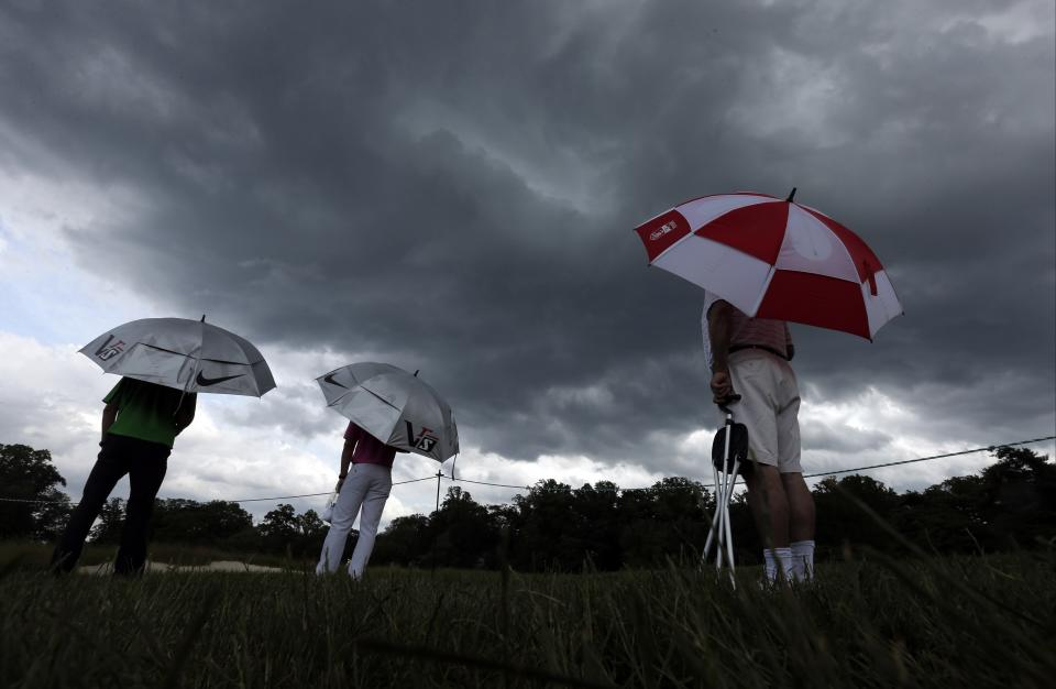 Spectators watch play during the first round of the U.S. Open golf tournament at Merion Golf Club, Thursday, June 13, 2013, in Ardmore, Pa. (AP Photo/Charlie Riedel)