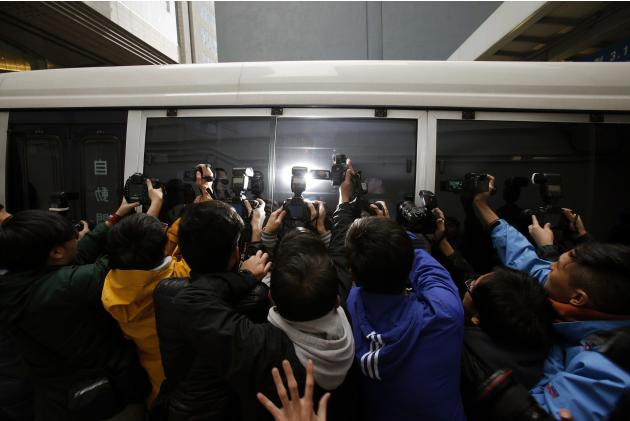 Photographers take pictures of Birmingham City Football Club owner Yeung in a Correctional Services van in Hong Kong