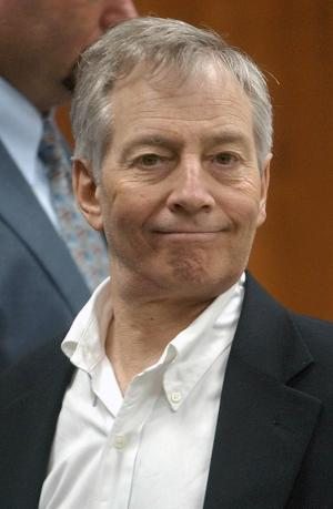 FILE - In this Sept. 25, 2003 file photo, Robert Durst smiles for the camera at the end of the day's testimony in his murder trial in Galveston, Texas. The New York City real estate heir who admitted killing his neighbor in Texas a decade ago is facing a new charge in Houston- that he urinated on candy at a drug store. (AP Photo/LM Otero, File)