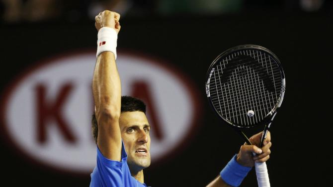 Djokovic of Serbia reacts after winning a point against Murray of Britain during their men's singles final match at the Australian Open 2015 tennis tournament in Melbourne