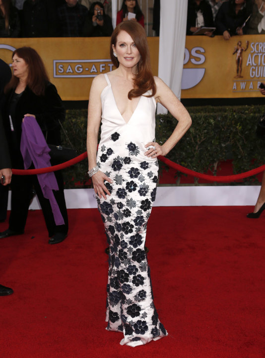 Julianne Moore arrives at the 19th Annual Screen Actors Guild Awards at the Shrine Auditorium in Los Angeles on Sunday Jan. 27, 2013. (Photo by Todd Williamson/Invision for The Hollywood Reporter/AP I