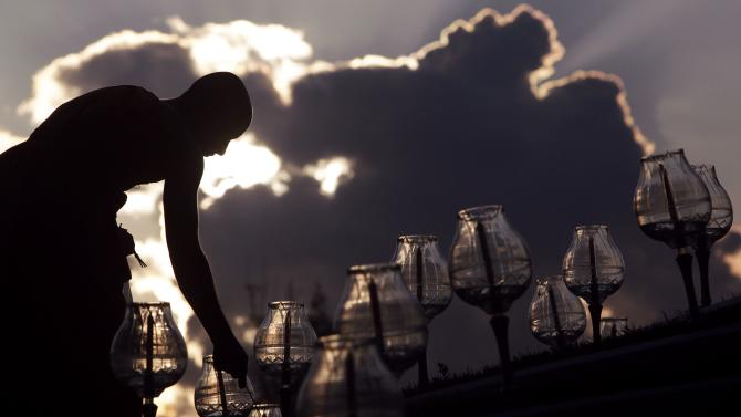 A Buddhist monk prepares candles for the main event of the Yee Peng festival at a temple in the northern capital of Chiang Mai