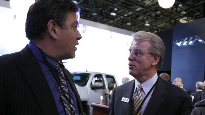 IMAGE DISTRIBUTED FOR PACIFIC GAS & ELECTRIC COMPANY - Pacific Gas & Electric Company vice president Greg Pruett, left, and VIA Motors chief operating officer Alan Perriton talk following a VIA Motors news conference on Monday, Jan. 14, 2013, at the North American International Auto Show in Detroit. (Al Goldis /AP Images for Pacific Gas & Electric Company)