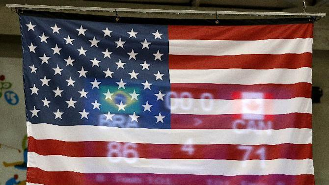 A United States flag is seen with the score of the gold medal game in which Brazil beat Canada 86-71 visible during the medal ceremony in the men's basketball tournament at the Pan Am Games, Saturday, July 25, 2015, in Toronto. The U.S. took the bronze medal. (AP Photo/Julio Cortez)