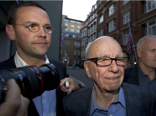 File - Chairman of News Corporation Rupert Murdoch, right, and his son James Murdoch, chief executive of News Corporation Europe and Asia arrive at his residence in central London, in this Sunday, Jul