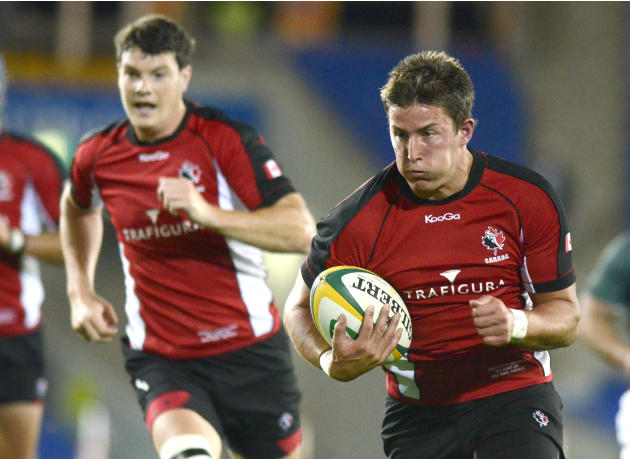 Canada's DTH Van der Merwe, right, and Ciaran Hearn run during their rugby union match against the Australia Barbarian's on the Gold Coast, Australia, Friday, Aug. 26, 2011. (AP Photo/Steve Holland)