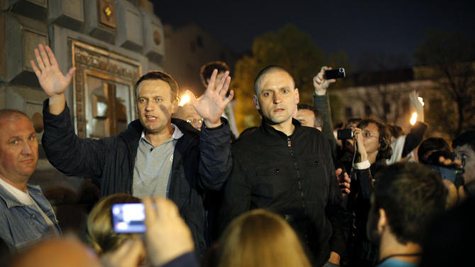 CORRECTS SPELLING OF SERGEI - Alexei Navalny, a prominent anti-corruption whistle blower and blogger, left, and opposition leader Sergei Udaltsov speak to protesters gathered near the presidential administrations building in downtown Moscow early Tuesday, May 8, 2012, a day after Putin's inauguration. Vladimir Putin took the oath of office in a brief but regal Kremlin ceremony on Monday, while on the streets outside thousands of helmeted riot police prevented hundreds of demonstrators from protesting his return to the presidency. (AP Photo/Alexander Zemlianichenko Jr )