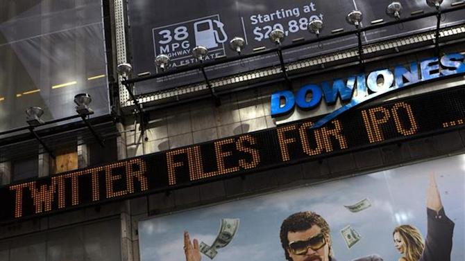A news ticker in New York's Times Square announces an initial public offering for Twitter Inc. September 13, 2013. REUTERS/Eric Thayer