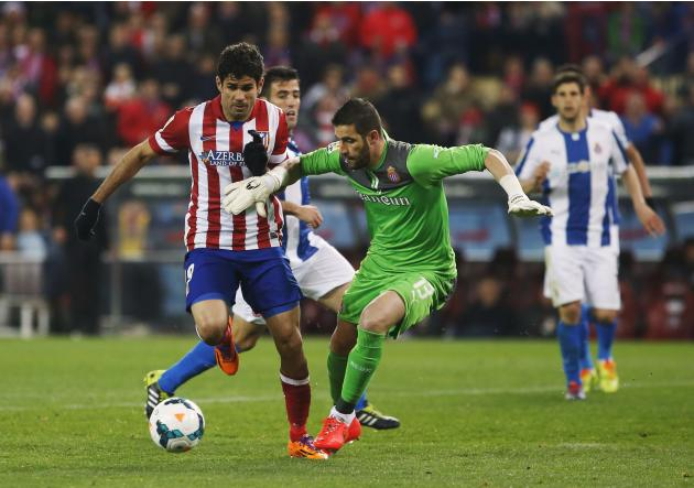 Atletico Madrid's Costa fights for the ball with Espanyol's goalkeeper Casilla during their Spanish first division soccer match at Vicente Calderon stadium in Madrid
